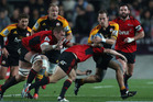 Andrew Horrell of the Chiefs is tackled during the Super Rugby semi final match between the Chiefs and the Crusaders. Photo / Getty Images