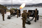 Soldiers firing 25 pounder guns during their 21-gun salute, to celebrate the arrival of the royal baby, from Point Jeringham in Wellington. Photo / Mark Mitchell