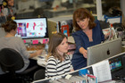 Editor Louise Wright (right) looking over one of the page designs in the royal baby special edition. Photo / Chris Loufte