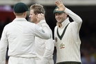 Australia's captain Michael Clarke, right, celebrates the wicket of Ian Bell during day three of the second Ashes Test match held at Lord's cricket ground in London, Saturday, July 20, 2013. (AP Photo