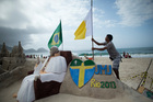 A street artist prepares for the pope's arrival in Rio de Janeiro, Brazil. Photo / AP