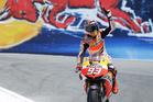 Marc Marquez, of Spain, celebrates after winning the U.S. Grand Prix MotoGP race at Laguna Seca raceway. Photo / AP
