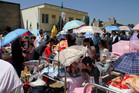 Residents gather at a makeshift on the grounds of a hospital for medical services after an earthquake hit Minxian county in northwest China's Gansu province.Photo / AP