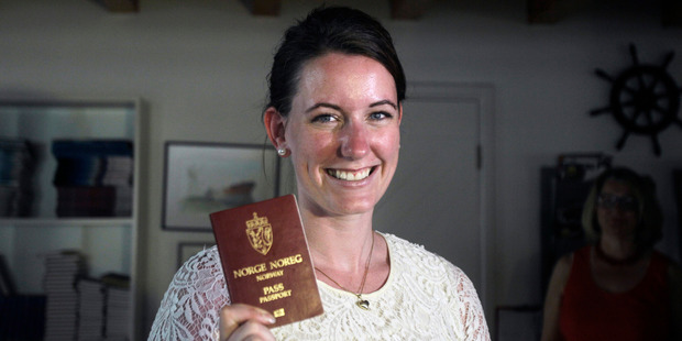 Norwegian Marte Deborah Dalelv, 24, shows her passport - her ticket to leave a country which jailed her over a rape claim. Photo / AP