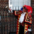 Tony Appleton, a town crier, rings his bell as he announces the birth of the royal baby, outside St. Mary's Hospital exclusive Lindo Wing in London. Photo / AP