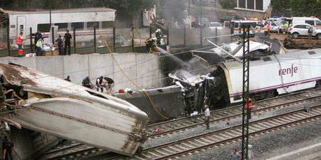 Emergency personnel respond to the scene of a train derailment in Santiago de Compostela, Spain. Photo / AP