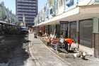 Repairs to earthquake damaged shops on New Regent Street after the Christchurch earthquakes. If a loss in profit was because of damage to a business's property, it was likely to be covered by insurance. If, however, the loss was due to fewer customers visiting the affected area, it may be excluded under another circumstances clause. Photo / File