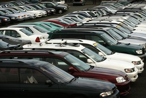 Second-hand Japanese import cars sit massed on Beaumont Street near Westhaven awaiting sales.