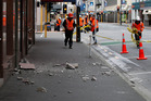 City council workers cleaning up debris from damage as a result of the 6.5 quake in Wellington. Photo / Mark Mitchell