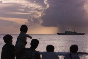 The Australian ship HMNAS Manoora at sunset off the central Pacific island of Nauru. Photo / Kenny Rodger