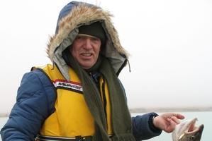 Despite low cloud and sub zero temperatures, Graeme Hughes enjoys some winter fishing. Photo / Regan Hughes