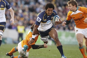 Henry Speight of the Brumbies is tackled during the Super Rugby qualifying final match between the Brumbies and  the Cheetahs at Canberra last night.  Photo / Getty Images