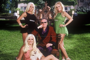 Hugh Hefner and companions at the Playboy Mansion.