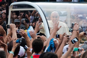 People reach out to Pope Francis as he arrives in Rio at a tense time for Brazil. Photo / AP