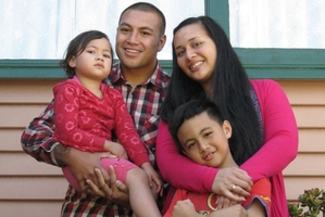 """The death of """"gentle giant'' Willie Halaifonua, pictured here on Facebook with his family, has prompted a flood of tributes."""