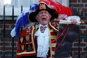 Tony Appleton, a town crier, announces the birth of the royal baby, outside St. Mary's Hospital exclusive Lindo Wing.Photo / AP