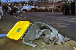 A wheelie-bins burnt in Dunedin. Photos / Stephen Jaquiery