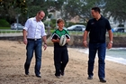 Kameron Greenlees, left, and Steve Price spend some quality time with Jacob Owens at Devonport Beach. Photo / Getty Images