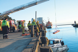 The boat hit the wharf with considerable force, breaking one of the wooden piles, and getting hooked up underneath in the superstructure of the wharf. Photo / Gisborne Herald
