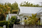 Even a humble dwelling costs a fortune in Auckland. Photo / Michael Craig