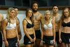 Black Sticks hockey players in a photo shoot with the Beast, Manu Vatuvei.