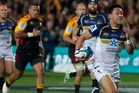 Christian Lealiifano on the way to his try last night. Photo / Alan Gibson