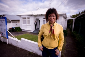 Home buyer Hongying Qiu checks out a house in Grey Lynn yesterday, before it goes to auction. Photo / Dean Purcell