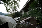 Wreckage from the bus is strewn across a ravine near Avellino, southern Italy. The bus plunged off the highway and into undergrowth 30m below the viaduct flyover. Photo / AP