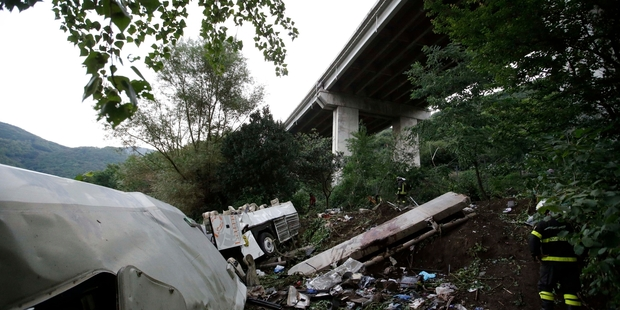 Loading Wreckage from the bus is strewn across a ravine near Avellino, southern Italy. The bus plunged off the highway and into undergrowth 30m below the viaduct flyover. Photo / AP