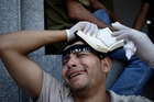 An Egyptian grieves after dozens of supporters of ousted President Mohamed Morsi were killed. Photo / AP