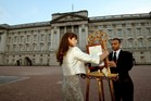 The Queen's Press Secretary Ailsa Anderson (L) with Badar Azim, a footman, place on an easel in the forecourt of Buckingham Palace a notification to announce the birth of Prince George.Photo / AFP