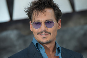Johnny Depp has hinted that he could retire from acting after calling the profession 'insane'. Photo / AP