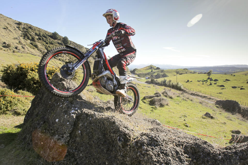 Carl Robson from Wellington tackles one of the many jumps on the moto trial course.
