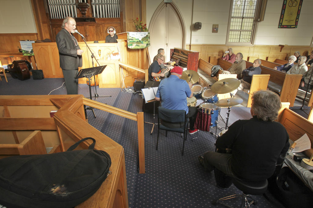 Napier band, Men Behaving Badly, with lead singer Bryan Church (left) entertained people at the Trinity Methodist Church in Napier on Saturday.