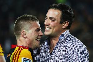 Gareth Anscombe celebrates with injured teammate Richard Kahui. Photo / Getty Images