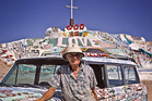 Leonard Knight in front of his Salvation Mountain. Photo / Jason Burgess