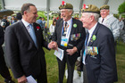 Prime Minister John Key chats to veterans in Busan, South Korea. Photo / NZ Defence Force