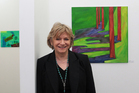 Deborah White from Whitespace Gallery Grey Lynn with painting by Lisa Rayner. Photo / Doug Sherring