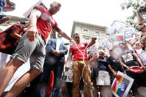 Gay rights activist dump Russian vodka during a demonstration in front of the Russian consulate in New York. Photo / AP