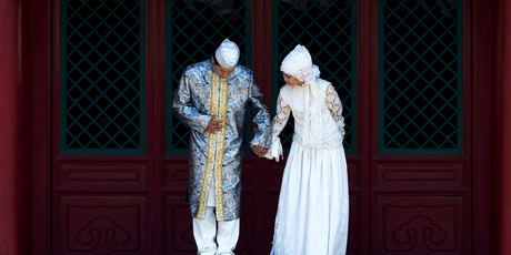 A Muslim newly wed couple prepares to pose for wedding photos at Niujie Mosque during the Muslim holy month of Ramadan in Beijing. Photo / AP