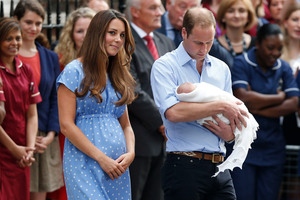 Britain's Prince William, right, and Kate, Duchess of Cambridge with the Prince of Cambridge. Photo / AP