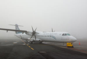 An Air New Zealand Link plane sits on the tarmac in thick fog. File photo / NZ Herald