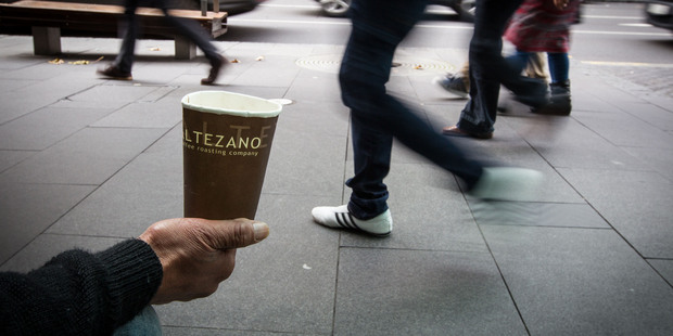 Loading Begging could be banned in Auckland's CBD after a council meeting today. Photo / Michael Craig