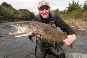 Fishing guide, Andrew Christmas with another big Tongariro trophy brown trout.
