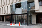 A large window shattered by the earthquake at the National Library in Wellington. Photo / Mark Mitchell