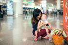 A Chinese mother feed her baby at a shopping mall in Beijing. The reputation of NZ dairy produce is getting a battering in the Chinese media. Photo / David White.