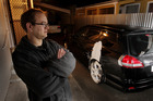 Hastings man Anthony Manley with his vandalised sedan.   Photo / Warren Buckland.