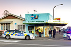 Police attend a armed robbery at the Sunshine Superette in Hastings Street, Napier. Photo / Glenn Taylor