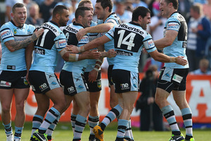 Michael Gordon of the Sharks celebrates with his team mates after scoring a try during the round 20 NRL match between the Cronulla Sharks and the Penrith Panthers. Photo / Getty Images.