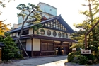 The Hoshi Ryokan, opened in 717, is the oldest hotel still in service today and, below, a tea ceremony master makes green tea. Pictures / Getty Images)